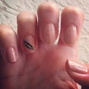Nude Nails with Feather Design