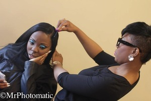 Photo taken by a photographer at the Msu fashion show!  My co worker is styling her hair ! I did the makeup!!!