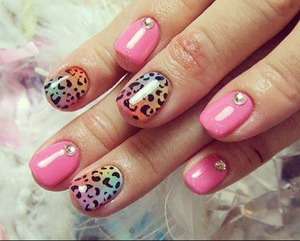 Pink and leopard print nails with rhinestones.