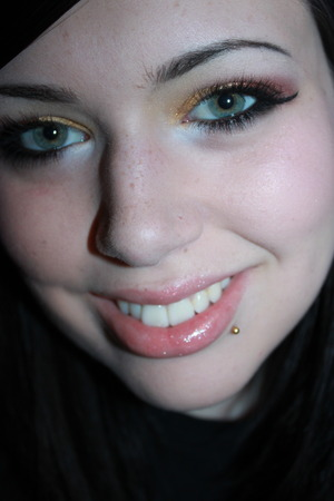 http://ticklemetonks.blogspot.com/2011/06/fotd-gold-deep-red.html