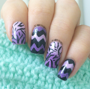 A manicure with a gorgeous purple ombre with chevron & zebra design!