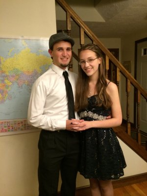 Picture of my boyfriend and I at homecoming! Isn't he a handsome one?! My hair was originally curled.... Only one curl stayed in the whole night 😂
