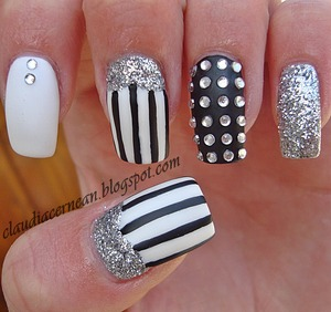 Tutorial on : http://claudiacernean.blogspot.ro/2013/04/unghii-cu-linii-lines-nails.html