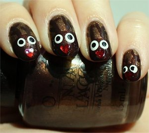 Nail tutorial & more photos here: http://www.swatchandlearn.com/nail-art-tutorial-reindeer-nails-rudolph-nails/