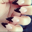 Stiletto tips with heart nail art