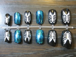 Buy them here: https://www.etsy.com/listing/111111572/rib-cage-glam-nail-set