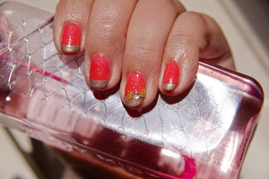 Funky french with bow accent.  Zoya Jules over Spiegel Coral(with glitters)