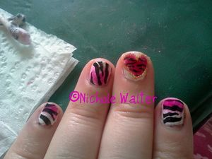 the print is stamped using salon express... the one in the heart is hand painted