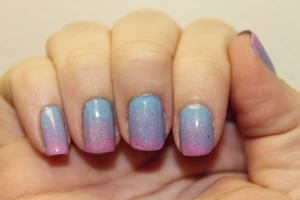 made with revlon dreamer (blue), sally hansen lively lilac (purple), and zoya sweet (pink). with holo topcoat from prettypolishnthings. (purchase HERE--> http://www.etsy.com/listing/102219285/home-made-full-sized-15ml-spectraflair? )