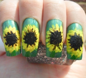 A Sunflower mani created using freehand acrylic paint.