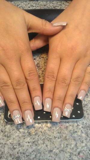 One of my customer was going to the Trey Songz concert. So I did nude solar nails and rhinestone bows. Follow me at @beautifullydee on instagram.