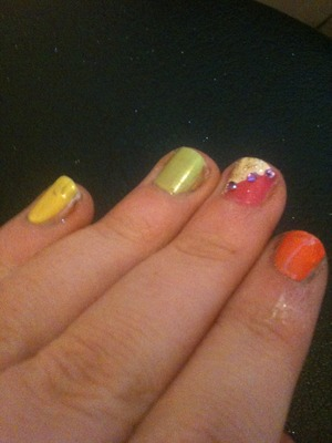 Products used-  Rimmel London 280 sunshine yellow 17 lasting fix green Rimmel London nail tip whitner white Natural collection coral orange-peach Totally tropical nail polish duo green and pink Feels- Claire's nail art kit