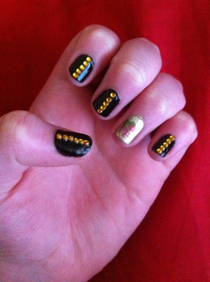 Gold and black studded nails with rose x