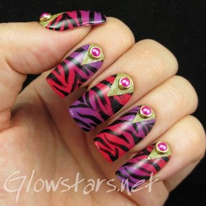 Read the blog post at http://glowstars.net/lacquer-obsession/2015/02/zebra-print-gradient-with-glitter-chevron-half-moons/
