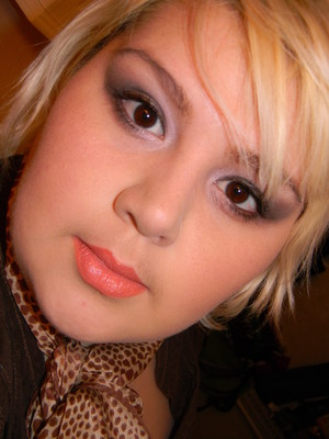 Coral/orangy lips paired with a soft brown smoky eye.