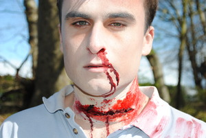 A theatrical makeup look based around a man murdered in the woods.