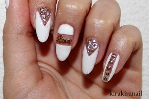 ♡ Products I used ♡ Nr. M103 by f.flormar (white) HEX Charm from http://www.hexnailjewelry.com/  Striping tape: http://global.rakuten.com/en/store/harukastore/item/10000103/  Round Studs from Nail Supply (rakuten.com) Square studs (1.5 mm) from Jewelry- Nail Square studs (2.0 mm) from Bornprettystore: http://www.bornprettystore.com/gold-square-stud-rhinestone-acrylic-nail-p-2860.html  Round studs (1.0 mm) from Jewelry- Nail Round Studs from Nail Supply (rakuten.com) Crystals from Studio Nail (rakuten.com): SS4, SS5 & SS9 Base and top coat