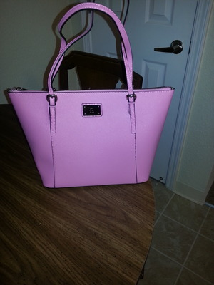 I love this purse. its the perfect size and the color is AMAZING!