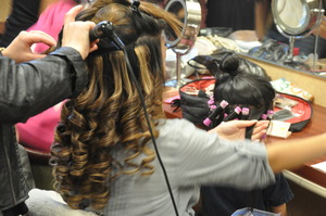 Getting my hair done while rolling one of my flower girl's hair :)