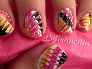 These nails are perfect for parties or just for feeling a little wild.  They are super easy to do.  Video Tutorial: http://www.polishpedia.com/tie-dye-nails.html