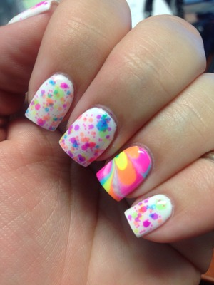 I used Lush Lacquer clowning around and water marbled with a few Orly neons from summer 2012.