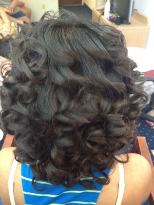 clip ons added to natural hair and curled