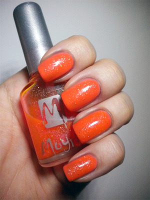 http://missbeautyaddict.blogspot.com/2012/03/31-day-challenge-orange-nails-essence.html
