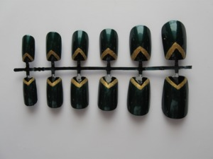 Buy them here: https://www.etsy.com/listing/106309084/green-and-gold-chevron-tip-nail-set