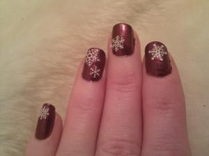 My nails done for the Christmas weekend.  OPI Swiss Collection:  Diva of Geneva as a base coat (3 coats to make it really dark) and a random snowflake pattern done with 3D/glitter snowflake decals.