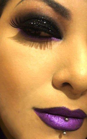 Black glitter eye with violet under eye and violet lips