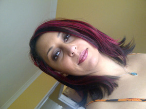 This photo shows my multi-toned hair very well.  Its dark brown as a base, layered with reds and pink highlights.
