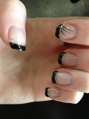 Black tips with design and glitter.