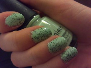 Mint ice cream! Two coats of China Glaze Re-Fresh Mint and three coats of Nicole by OPI Pitch Black Glimmer.