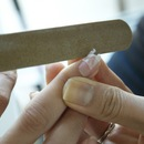 Trim away the excess paper then file the edges for a smooth finish
