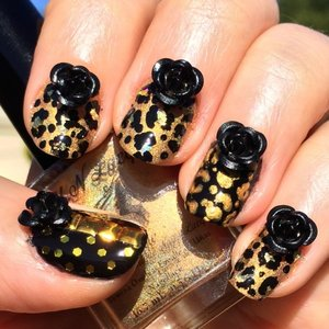 http://michtymaxx.blogspot.com.au/2014/05/golden-leopard-nail-tutorial-ft-fun.html  I have a nail tutorial featuring some pretty polishes from F.U.N Lacquer and these awesome black 3D Roses that I received from the Born Pretty Store.   In this tutorial I show you different ways to use glitter top coats to create a leopard design and how to place hex glitter with dotting tool to make a glittery polka dot effect.