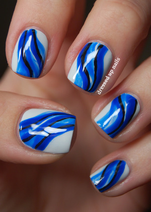 Got the idea from a pretty painting that's linked on my blog post. The blue is all China Glaze Ride the Waves in different numbers of layers!  http://www.dressedupnails.com/2013/01/the-digit-al-dozen-does-art-day-3.html