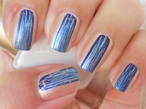OPI - Navy Shatter over nude nail polish