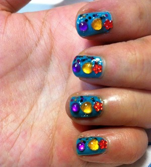 3 difference rhinestones together with glitter nail polish and dark teal nails;)