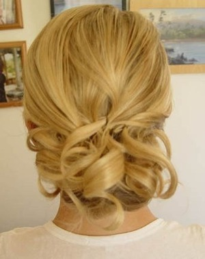 found on pinterest (not my work) but this is a pretty/simple Updo for medium/short hair