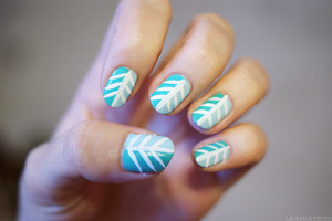 """I used Essie """"Mint Candy Apple"""", Barielle """"Do Unto Others"""", and a white striper to create this look."""