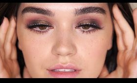 Pinks and Browns smokey eyes with a blue accent