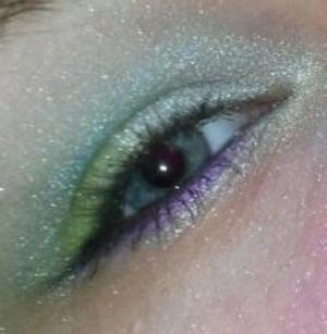 attempt at jewel tones peacock inspired look.. i only used drugstore shadows with low quality and i need better brushes. hopefully after i get those things, my next attempt will improve :)