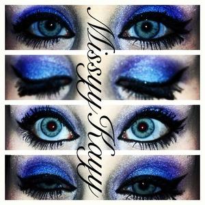 Blue & purple eyeshadows and a cateye.