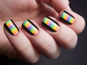 Love the black nails with the rainbow streaks going down the middle