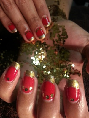 Beautiful Red gel polish with gold pigment burnished onto the tips ..and medallions of gold dot the moons of this Indian bride.