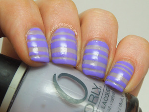 Two toned purple striped pattern using Julep and Orly. More info can be found on my blog post: http://www.lacquermesilly.com/2013/05/24/purple-stripes/