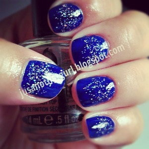 Royal blue w/ a little glitter on top.