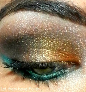 A smokey look with touches of metallic Gold and Aqua