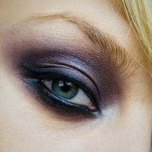 smokey eyes make-up, using shades of deep violet and grays