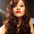 Curled hair, red lip